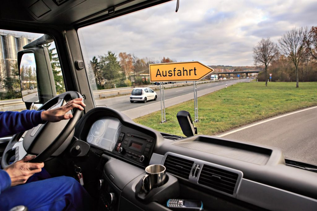 Corporate Truck Driver on Road